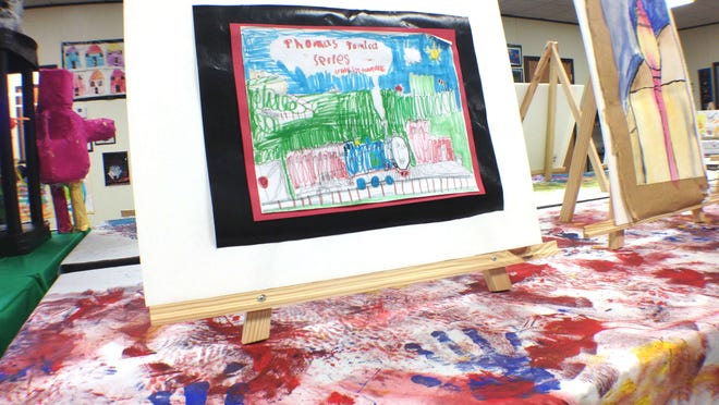 An art show on Saturday at the Arc of Southeast Iowa featured art by local children with autism.