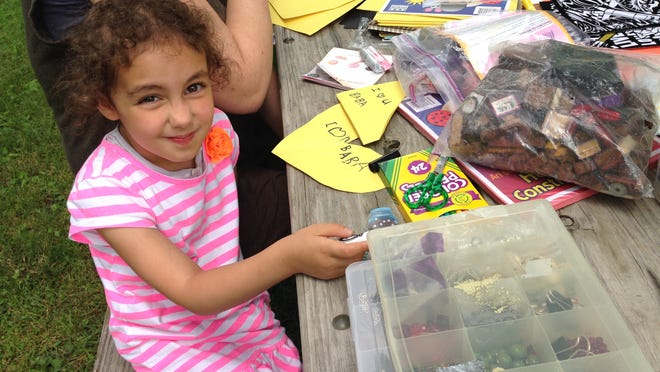 Alia Sabha, 4, draws at Art in the Park Sunday afternoon at Highland Park in Iowa City.