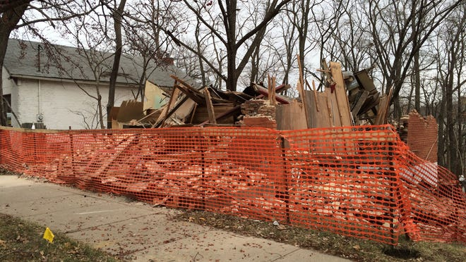The former Moy Yat Ving Tsun Kung Fu at 614 S. Dubuque St. was torn down between late Thursday and early Friday, a neighboring tenant said.