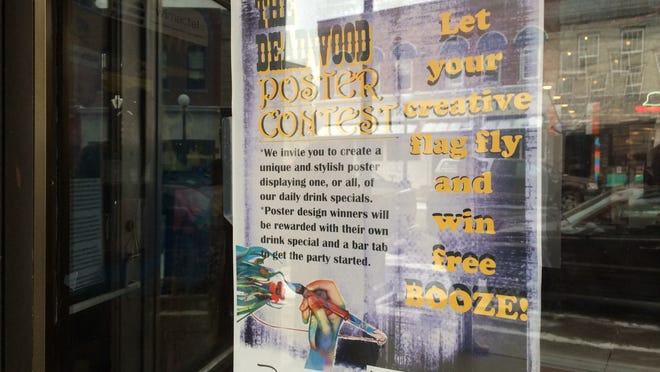 A flier posted outside the Deadwood Tavern at 6 S. Dubuque St. Monday says that poster contest winners will be rewarded with their own drink special and a bar tab. Tim Schuett, a tavern employee who suggested the contest, said patrons in the bar and fans on Facebook will vote for the winning posters.
