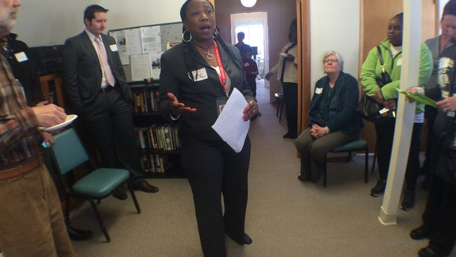 Carolyn Porter, coordinator for the Inside Out Reentry Program, speaks to the gathered crowd at the First Baptist Church in Iowa City during the group's open house Thursday afternoon.