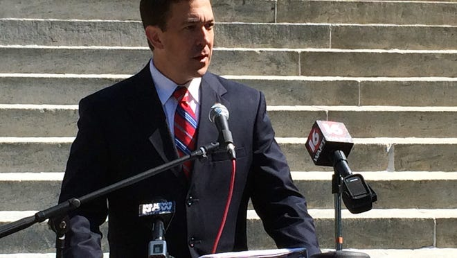 Senatorial candidate Chris McDaniel speaks to the press Thursday on the south steps of the Mississippi State Capitol in Jackson.