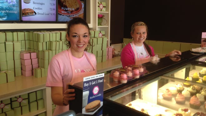 Scarlett Smith and Sarah Frank pause between customers at Gigi's Cupcakes.
