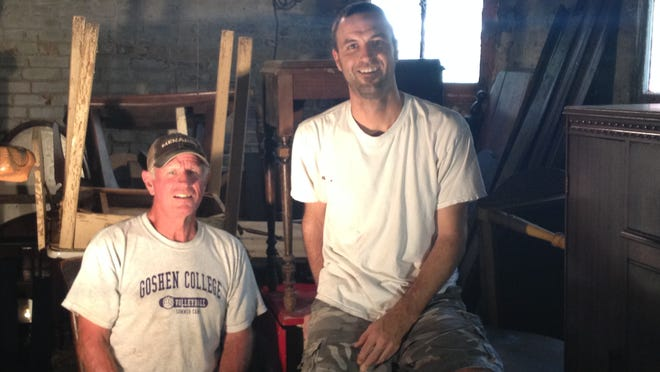 Craig Swearingen, right, of Chalmers is using Twitter to promote an upcoming garage sale that will feature antique and vintage items that his stepfather Bill Zobrist has collected over 30 years.
