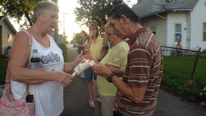Friends and family gathered Friday, August 22, 2014 for a candlelight vigil at Rick Couch's home in the 1500 block of N. 16th Street in Lafayette, where he was found beaten to death on Wednesday.
