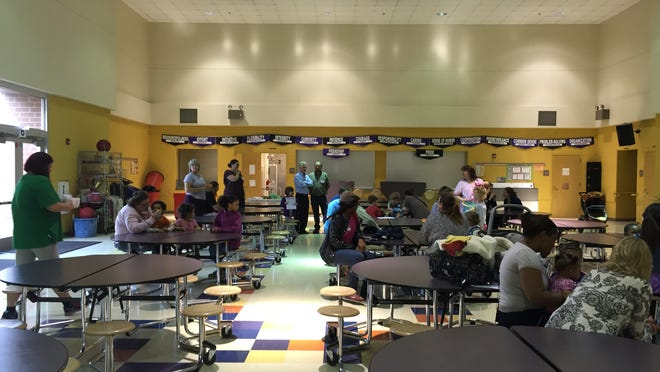 A dozen families filled the cafeteria at Miami Elementary School for bornlearning, a United Way program designed to help parents prepare their children for kindergarten.