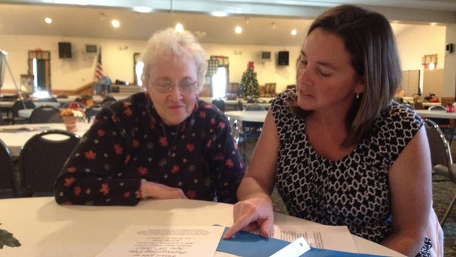 Marjorie Huva (left) and Jennifer Packowski of Charlotte's First Lutheran Church volunteer in for the free community Thanksgiving dinner at the Eaton Area Senior Center.