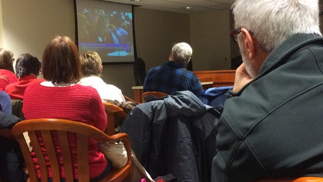 The crowd was so large at a House Oversight Committee hearing on smart meters Tuesday night that overflow was forced into a second committee room across the hall. This photo shows the overflow crowd watching the committee hearing on a television screen.