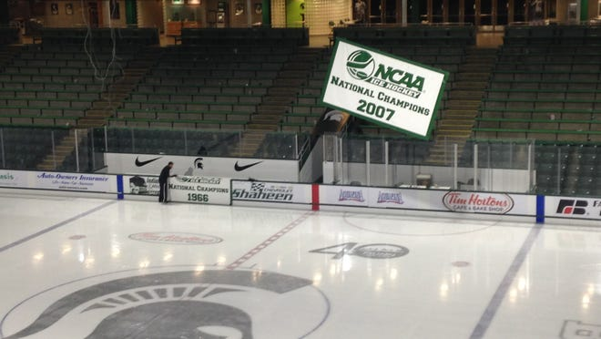 MSU's three national championship banners came down after Sunday's 6-4 Spartan victory over Clarkson at Munn Arena. They are being removed to make way for a new four-sided, high-definition video scoreboard that will be installed this week.