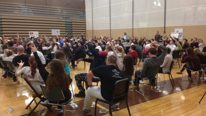 Some 180 students and 50 adults participate in Challenge Day on Friday at Holt High School.