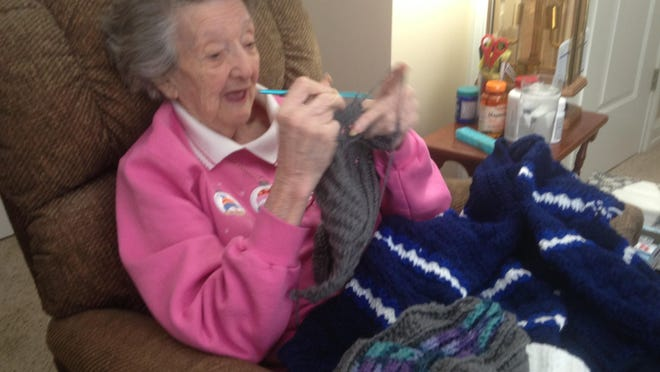 Ruth Coan of Holt, 94, crochets a hat that wil be donated to the Our Savior Lutheran Food Bank in Lansing.