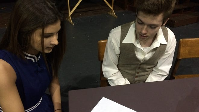 """Allison Ackerly and Josh Delany are shown as the title characters in Williamston High School's upcoming production of """"David and Lisa."""" The Lisa Brandt character has two personalities, and the one shown here communicates only through writing."""