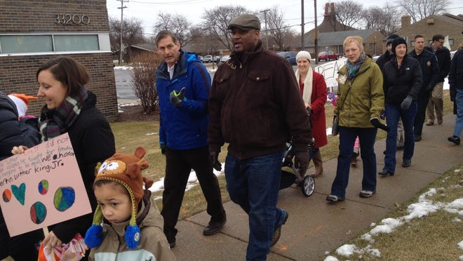 The MLK Day celebration in Farmington Hills drew 70-some residents for the traditional march along 12 Mile Road. Activities continued at the Farmington Community Library's 12 Mile Road branch.