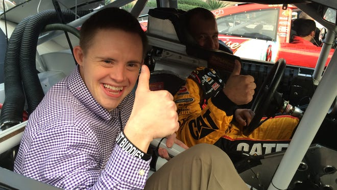 Fern Creek resident Daniel Noltemeyer, 32, gets a ride with NASCAR driver Ryan Newman before the Sprint Cup Series Awards banquet in Las Vegas. Noltemeyer won the Betty Jane France Humanitarian Award at the banquet.