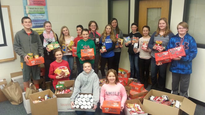 Members of the Mishicot Middle School student council display the donations received during a food drive in February. Students coordinating the drive were, kneeling from left, Jada Haese, Ethan Brossard and Eliza Griffey; standing from left, Nathan Driscoll, Stephanie Bressler, Breanna Reinhart, Gavin Junk, Abby Garceau, Kourtney LeRoy, Abbi VanHefty, Taylor Krueger, Taylor Weger, Kally Krueger, Samantha Anhalt and Kyle Mehorcyzk.