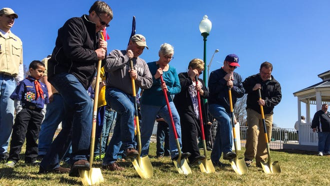 From left, Spencer Village Board members Wayne Hagen, Tom Schafer, Diane Maurer, Pauline Frome and Harry Toufar, and contractor Kevin Kulke, take part in a groundbreaking ceremony held Saturday for a new veterans memorial in Spencer.