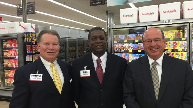 Brookshire Grocery Co. regional manager Donnie Byars, Monroe DeSiard Street store manager Bill Braggs and company CEO Rick Rayford celebrate the renovation of the store during a grand opening event in April.