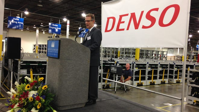 Plant director Mike Bowman speaks Thursday at the ribbon cutting for DENSO Corp.'s new Montgomery facility.