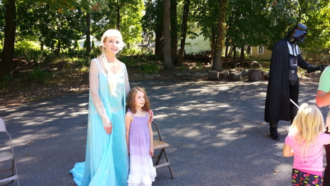 "Julia Suttile poses with ""Elsa."""