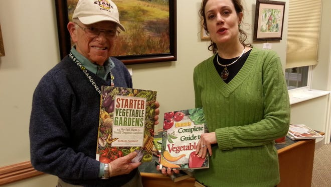 Stan Nathanson, left, Rutgers Master Gardener with Jacqueline Zuzzi, library director, Washington Township Public Library.