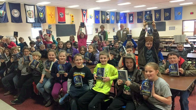Flippin Elementary School third-graders are shown with personalized dictionaries recently distributed by the Bull Shoals-Lakeview Rotary Club. The club distributed 61 dictionaries as part of a program it has continued for 15 years.