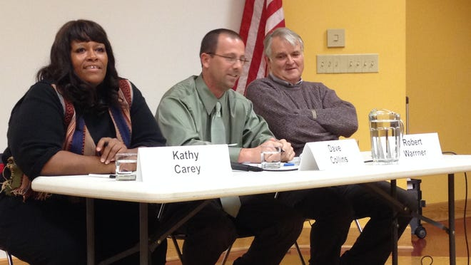 Kathy Carey, Dave Collins and Robert Warrner participate in a recent forum hosted by the League of Women Voters.