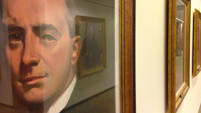 """A painting of Michael D. Kelly, president of Muncie National Institute from 1912-1917, hangs on the """"wall of presidents"""" on the second floor of Ball State University's Bracken Library."""