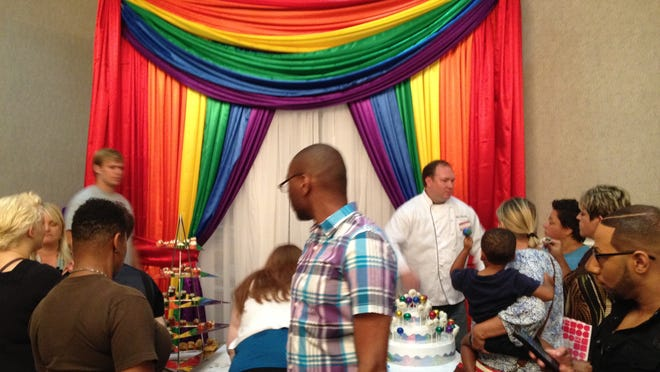 """A local maker of sweets was a popular stop at the July 20 """"Same Love, Same Rights"""" LGBT Wedding Expo at the Millennium Maxwell House Hotel."""