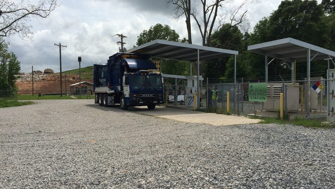 One of the new automated trucks purchased by the St. Landry Parish Solid Waste Commission is parked at the new renewable fuel station in Opelousas.
