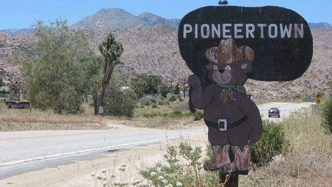 An old sign stands near the main road running through Pioneertown, Calif.
