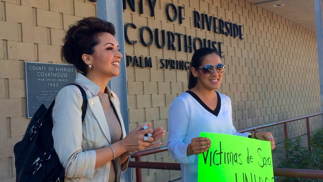 Attorney and community activist Rosa Elena Sahagun shares a moment with her client, Lindy Brau, who successfully won a lawsuit against an immigration consultant.