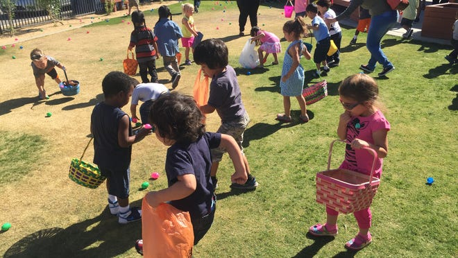 Children tried to grab as many eggs as they could at the Easter egg hunt at the Boys & Girls Club in Desert Hot Springs.