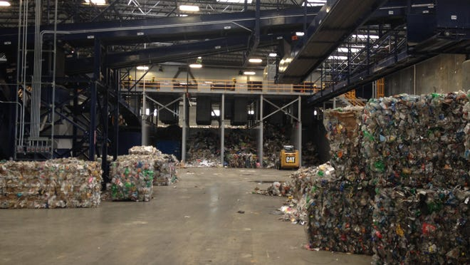 Bales of recycled goods crowd the floor of Infinitus Energy's Montgomery materials recovery facility in Montgomery, Ala. The company sells the goods on the global commodities market and returns a portion of the profit to the Emerald Coast Utilities Authority.