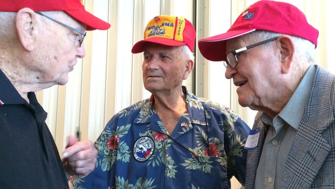 From left to right: Lt. Wayne Tappan, Sgt. Maj. William Braddock and Sgt. Hardy Napoleon Eubanks, Iwo Jima survivors, catching up at the Pensacola Marine Corps League, Navy League and Marine Corps Aviation Association's Iwo Jima Remembrance event March 27.