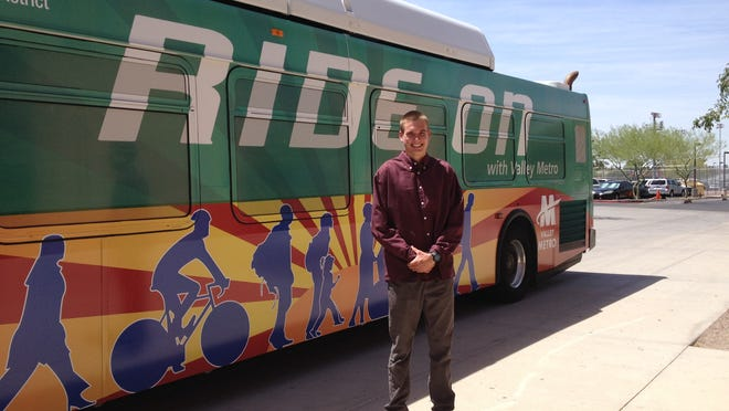 "John Reniewicki's <137>CQ<137>colorful version of the Arizona flag with the motto ""Ride On"" will decorate one Valley Metro bus and one light-rail car for a year.<137>CQ The Arcadia High School student won a contest to design a wrap for the transit system. More than 120 students from 20 high schools submitted designs to Valley Metro's ""Design a Transit Wrap"" contest.CQ<137>"