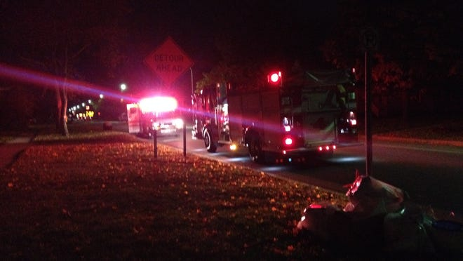Units from the Port Huron Fire Department and Tri-Hospital EMS stage outside a residence in the 1600 block of Griswold Street after receiving reports of a stabbing Wednesday, Oct. 22, 2014.