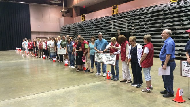 Walkway Over the Hudson volunteers practice Tuesday at the Mid-Hudson Civic Center for a Guinness World Record-breaking attempt on the bridge Sunday morning. Participants will try to create the world's longest handshake relay.