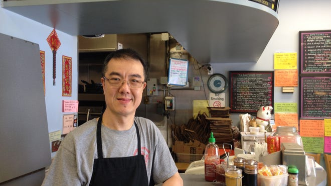 Eddie Pun, owner of Oriental Kitchen, near the IBM East Fishkill plant. Pun opened his restaurant during IBM's layoffs in the early 1990s.