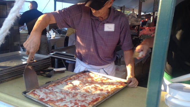 Thomas Giudice makes pizza on Sunday evening during Festa Italiana 2014, the Italian's Center's biggest annual event.