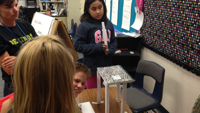 Dayton Elementary School STEM teacher Jenni Workman works with Jon Gerard and Vanessa Flores.