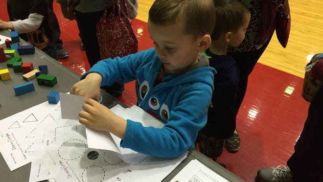 Collin Rice practices cutting along a line at a previous Richmond Community Schools kindergarten registration.