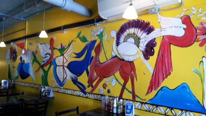 This mural at Salena's Mexican Restaurant in the Village Gate is by artist and restaurant waitress Kathy Smith. She has begun teaching art classes in a party room at the restaurant.
