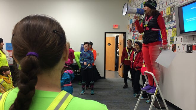 Fleet Feet's Ellen Brenner outlines the rules of the store's Winter Warrior program at Tuesday night's hill workout.
