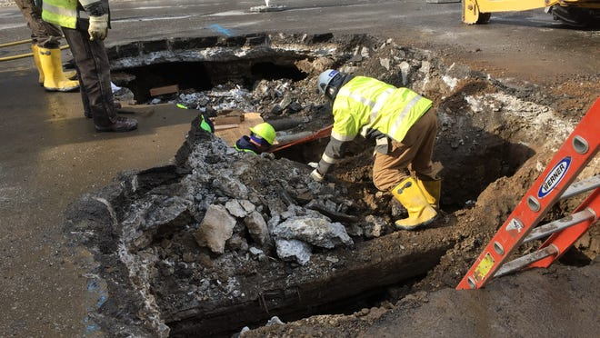 In February, crews work at the site of a water main break on State Street near Main.