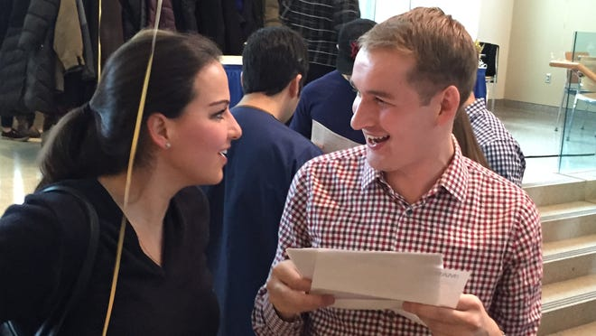 University of Rochester School of Medicine and Dentistry students Sofia Teresa Melgarejo, left, and Nathaniel Bayer talk about where they will be residents after learning of their assignments on Match Day.