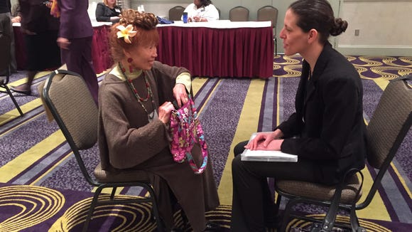 """Heide Parreno, left, and Becky Lyons are a """"family"""" during a poverty simulation hosted by the Finger Lakes Health Systems Agency Thursday."""