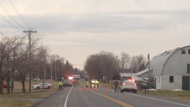 Police and fire engines at the scene of Friday's fatal crash on Allen Padgham Road in Farmington.