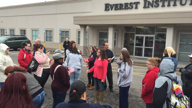 Students gather outside the Everest Institute on Portland Avenue in Irondequoit after learning that the school was abruptly closing a year ago.