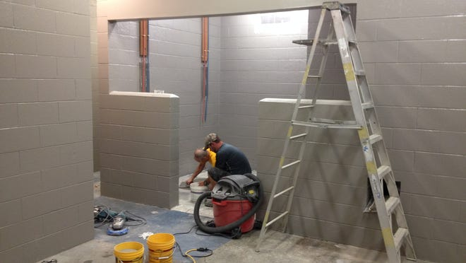 The floors of the Stayton Pool locker rooms stand to get a lot of attention in the coming weeks, while the walls have been painted a timeless classic color, gray, as part of the pool's maintenance project this month.