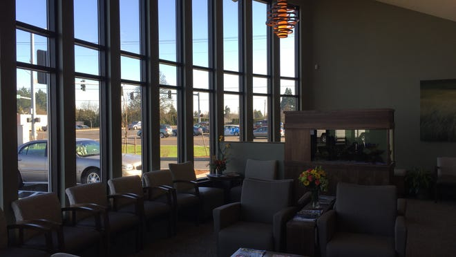 The lobby of the new facility features floor-to-ceiling windows and was designed to be comfortable and inviting.